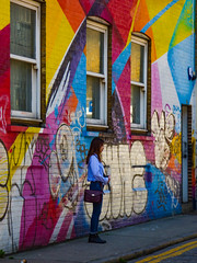 Waiting for Inspiration (Steve Taylor (Photography)) Tags: handbag art graffiti mural streetart tag building street colourful lady woman uk gb england greatbritain unitedkingdom london
