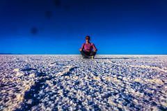 Amanda meditating on the salt flat.