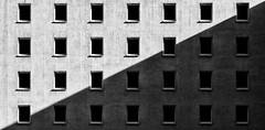 Sunlight and Shadow (laga2001) Tags: sunlight shade shadow windows facade geometry structure pattern diagonal transvers house building constant regular black white monochrome architecture bw leipzig germany canon triangle