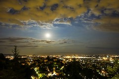 Nighttime in Bergamo - Moon Eclipse series (Mario Ottaviani Photography) Tags: sony sonyalpha italy italia paesaggio landscape travel adventure nature scenic exploration view vista breathtaking tranquil tranquility serene serenity calm marioottaviani nighttime bergamo bergamoalta moon luna notte clouds wideangle tamron lights cityscape citylights eclissidiluna eclipse partialeclipse partiallunareclipse lunareclipse eclissi eclisse