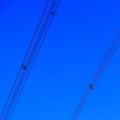 connections (vertblu) Tags: transmissionlines overheadpowerlines linesandstripes smileonsaturday powerlines blueskies blue simple simpleyeteffective boldandsimple minimal minimalism minimalismus 500x500 kwadrat bsquare vertblu lookingup diagonal graphic graphical monochrome onblue abstract abstracted abstraction abstractsquared kabel linien skies himmel