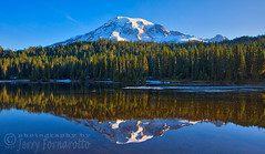 Mount Rainier reflecting on Reflection Lake (Jerry Fornarotto) Tags: beautiful cascade clear cr2017 dawn evening forest hiking jerryfornarotto lake landscape mountrainier mountrainiernationalpark mountain mountains nature northwest outdoors paradise rainier reflection reflectionlake scenery scenic snow stratovolcano sunrise travel trees usa washington water west western wilderness