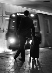 Man and Metro Train, Washington, DC (dckellyphoto) Tags: train metro wmata station underground man suit bag leaning subway washingtondc washington districtofcolumbia subwaystation monochrome arrive arrival standing metrocenter 2017 male businessman dark noiretblanc