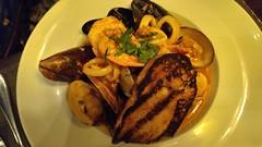 Cioppino with clams, calamari, mussels, shrimp (Joel Abroad) Tags: waltham massachusetts redbird restaurant food cioppino stew clams calamari mussels shrimp garlicbread