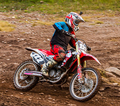 Honda In The Turn (John Kocijanski) Tags: red motocross motorcycle race sport people rider vehicle dirtbike canon70300mmllens canon7d