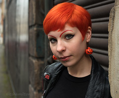 The Girl with Orange Hair (Charles Hamilton Photography) Tags: glasgow trongate characterstudy citycentre colourstreetportrait hairstyle halloween backstreet glasgowstreetphotography glasgowstreetportrait nikond750 portrait peopleinthecity people portraitofgirl primelens naturallight orange eyecontact charleshamilton urban shutters cshamilton223gmailcom