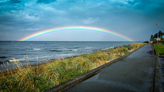 Rainbow Dreams (Sworldguy) Tags: rainbow qualicumbeach britishcolumbia vancouverisland waterfront ocean walk beach canada clouds rain scenic sky