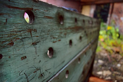 Old Wood Wheeled Crate (jna.rose) Tags: urbandecay urban urbanexploration urbex old wood crusty gritty focus depthoffield shallow holes chipping paint green tone photography outdoor abandoned factory abandonedfactory abandonedbuilding decayed