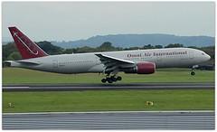 (Riik@mctr) Tags: manchester airport egcc n819ax grass airplane sky tree omni air international boeing 777 msn 33681 ex 5ykqu