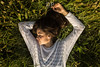Let Me Sleep In A Green Ocean (Daniele Pauletto) Tags: grass light nature landscape model girl fashion sensual goldenhour hope modella dress beauty bellezza ocean dpphotography