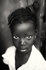 Ghana, young girl in Winneba (Dietmar Temps) Tags: africa afrika afrique tribes ethnic ethnology ethnie culture tradition traditional ritual people face child girl outdoor eyes naturallight beautifulgirl 50mm monochrome blackandwhite streetphotography fishingvillage streetlife ghana goldcoast accra winneba