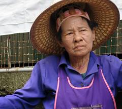 Old thoughtful woman (Robyn Hooz) Tags: thai thailand bangkok woman donna vecchia oild hat anziana expression portrait ritratto street