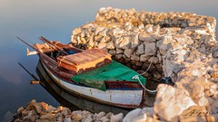 WEATHERBEATEN (zkapov1) Tags: croatia adriatic islandpag povljana canon sigma8514 brenizer boats green sea seascape rocks stones reflections harbour stillness oars berth ropes