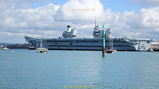 Queen Elizabeth Supercarrier as seen from the ferry to the Explosion Museum  one of the attractions at the Portsmouth Historic Dockyard in September 2017, Portsmouth, Hampshire, England.