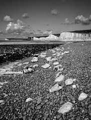 Stepping Stones (Explored) (Lloyd Austin) Tags: explore sevensisters people blackandwhite bnw bw cloudscape sky clouds landscape seascape water coastline coastal cliffs chalk stones tide ocean sea beach eastsussex birlinggap steppingstones monochrome mono pebbles