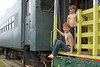 Riding the Rails (babyfella2007) Tags: jason taylor clawfoot bathtub claw foot cast iron bath railroad train fairfield county sc south carolina winnsboro grant carson shirtless no shirt engine locomotive passenger car climbing water wet hug hugging brothers brother riding decay old young decaying abandoned abandon rust rusty rail