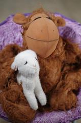 A Sentimental Pair (erluko) Tags: purple white brown objectsofsentimentalvalue smileonsaturday monkey lamb stuffedanimals toys strobe flash lighting smcpentaxf11750mm fuzzy fluffy fun smile friends cuddles