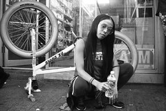 Squat For Arts and Cycling (runatail) Tags: runatail portrait people woman bicycle pkripper clintonstreet lowereastside newyorkcity manhattan blackandwhite monochrome glasses streetphotography urban citylife
