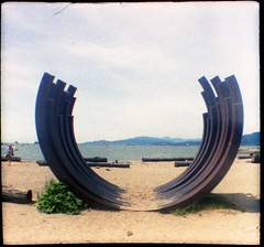 on the beach (Beaulawrence) Tags: film grain analog lomography diana dianababy 110film plasticlens plasticfantastic toycameratoy expiredfilm kodak kodakgold 200asa square sooc ishootfilm downtownvancouver beach publicart circles