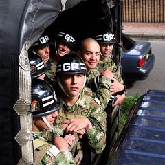 GR (Ashley Watts) Tags: colombia bogota travel gr army military olympus omd em5 25mm zuiko truck boy girl protect armed helmet forces camouflage transport us sheffield derbyshire