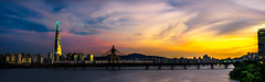 Lotte World Tour and a Sunset (Deibertography) Tags: lotteworldtower seoul southkorea city clouds night overcast panorama sky skyscraper sunset ultrawide urban wide widescreen
