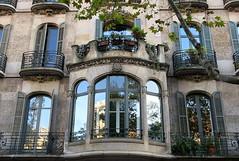 A balcony-crowned oriel, Barcelona (Spencer Means) Tags: dwwg architecture building house apartment window balcony bay oriel wroughtiron ironwork shutters crown parapet modernista modernisme dreta eixample barcelona catalonia catalunya spain balcón balkon