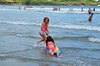 Violet Pulling Gabriella (Joe Shlabotnik) Tags: july2017 higginsbeach violet boogieboard 2017 maine gabriella ocean beach afsdxvrnikkor55300mm4556ged