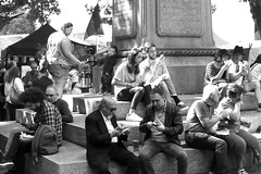 Lunchtime in Greenwich, London..... (markwilkins64) Tags: street streetphotography people bw blackandwhite mono monochrome lunchtime summer autumn shadows greenwich london uk couples monument mother child flag light shadow beer lager mobilephones sandwiches lunch rest friends partners family canon