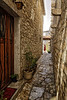 Walking In A World Of Rocks (Alfred Grupstra) Tags: architecture street house old town cultures village alley europe narrow history stonematerial cobblestone buildingexterior door travel outdoors ancient medieval city woman red