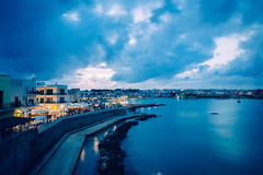 Otranto, Italy - Blue Light (Regan Gilder) Tags: italy puglia theheel southernitaly harbour sea ocean evening eveninglights nightlife nightlights nightsky nightshot night dusk twilight bluelight sky clouds blue lights citylights city holiday summer europe canoneos5dmarkiii canon eu