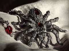 There's a spider on my pillow! (docoverachiever) Tags: stilllife scarey spider macro manmade halloween home object macromondays jewelry metal