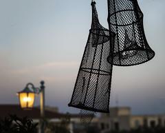 Fishing the light (nicolamarongiu) Tags: nasse orosei paesi colori silhoutte fishing light sera luci blue