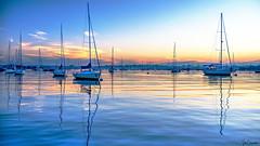 Newport Harbor at Dawn (Ian Charleton) Tags: boats sunrise sunset dawn bay harbor water reflection sailboat ship town sky clouds cpf polarizingfilter