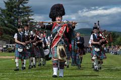 Strathisla Drum Major (Silver Machine) Tags: scotland dufftown 125thdufftownhighlandgames pipebands piper drummajor strathislapipeband marching bagpipes fujifilm fujifilmxt10 canonfd85mmf18