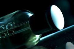 Sidelit Boss for Macro Mondays (Wim van Bezouw) Tags: macromondays sidelit boss bottle flash strobist sony ilce7m2