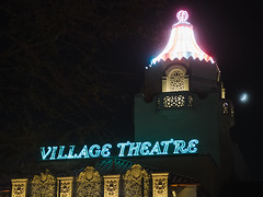 Village Theatre (BurlapZack) Tags: olympusomdem5markii olympusmzuiko45mmf18 vscofilm pack01 dallastx highlandpark villagetheatre movietheater neon telephoto availablelight handheld lowlight highiso moon crescentmoon glow night nightlife movies microfourthirds