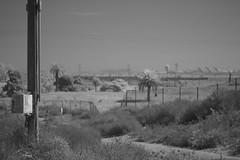 Shifting sands I. (helioshamash) Tags: ir infrared digital los angeles urban decay airport power lines utility pole apocalypse monochrome black white bw