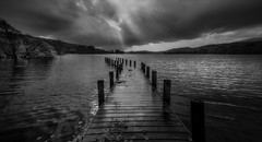 A glimmer of hope.. (Einir Wyn Leigh) Tags: landscape moody blackandwhite monochrome black white water lake jetty light outside storm shadow dark sunbeam