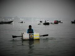 Varanasi 48 - river vendor (juggadery) Tags: 2015 india uttarpradesh varanasi benares banaras kashi cityoflight water ganga ganges boattrip people religion hindu