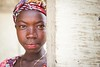 The Girl from Behind the Wall (Miro May) Tags: afrika africa afrique sierraleone portrait girl woman style lifestyle eyes lips face closeup beautiful beauty culture colors colourful ethnic ethnology ngc