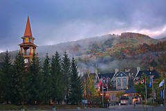 7am at Mont-Tremblant Village (lfeng1014) Tags: monttremblantvillage monttremblant mistymorning autumncolours laurentianmountains quebec canada pedestrianvillage skiresort clocktower 7am canon5dmarkiii 70200mmf28lisii landscape fallcolours foliage building architect travel lifeng