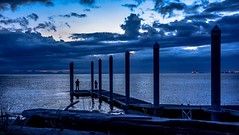 Blue hour fishing (Christie : Colour & Light Collection) Tags: fishing bluehour stormy dock wharf pier bc canada usa pointroberts moody cloudy logs water nikon people evening night nightfall pilings beach shore lighting sky outdoors silhouette