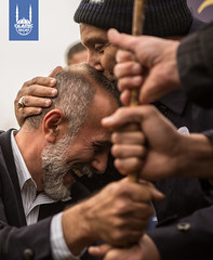 Dr. Hany El-Banna, founder of Islamic Relief, kisses the forehead of IR Bosnia's Country Director, Semir Velija. The two planted the first tree, visibly moved by the significance of this milestone.
