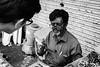 Bargaining (gaalvarezc) Tags: street streetphotography photography bw blackwhite blackandwhite black white people india hyderabad unexpected bargaining bazaar charminar canon seller portrait
