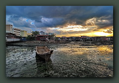 Low tide, Muddy, Storming sunrise (Godoly) Tags: mud storm sunrise morning weather