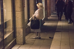 Window shopping lady in Stockholm (stenaake) Tags: lady sweden nk stockholm white old woman dressed window hamngatan windowshopping looking night dark light evening fashion oldfashion hat bag bags cane