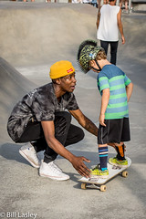Helping Hands (informalphotography) Tags: skateboard skateboardpark teaching venicebeach white black generations old skateboarders young