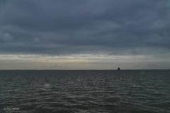 Rain at sea (jehazet) Tags: seascape rain clouds waddenzee wolken regen