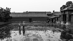 Overtime? (Go-tea 郭天) Tags: pékin beijingshi chine cn beijing forbidden city imperial palace candid ancient construction building pavillon door gate house wodden rain rainy raining wet puddle water pavement brush hat old men workers working duty busy walk walking clean cleaning cleaner bag pots reflection together team street urban outside outdoor people bw bnw black white blackwhite blackandwhite monochrome naturallight natural light asia asian china chinese canon eos 100d 24mm prime