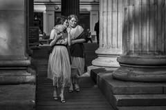 Always The Bridesmaid... (Leanne Boulton) Tags: urban street candid portrait streetphotography candidstreetphotography candidportrait streetlife woman women female girl girls face faces facial expression gesture look emotion feeling wedding mood atmosphere dresses bridesmaid column architecture posy tone texture detail depthoffield bokeh naturallight outdoor light shade shadow sunlight city scene human life living humanity society culture people canon canon5d 5dmkiii 70mm ef2470mmf28liiusm black white blackwhite bw mono blackandwhite monochrome glasgow scotland uk